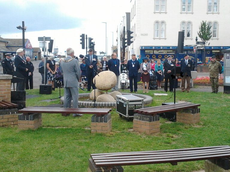People socially distancing met to celebrate Armed Forces Day