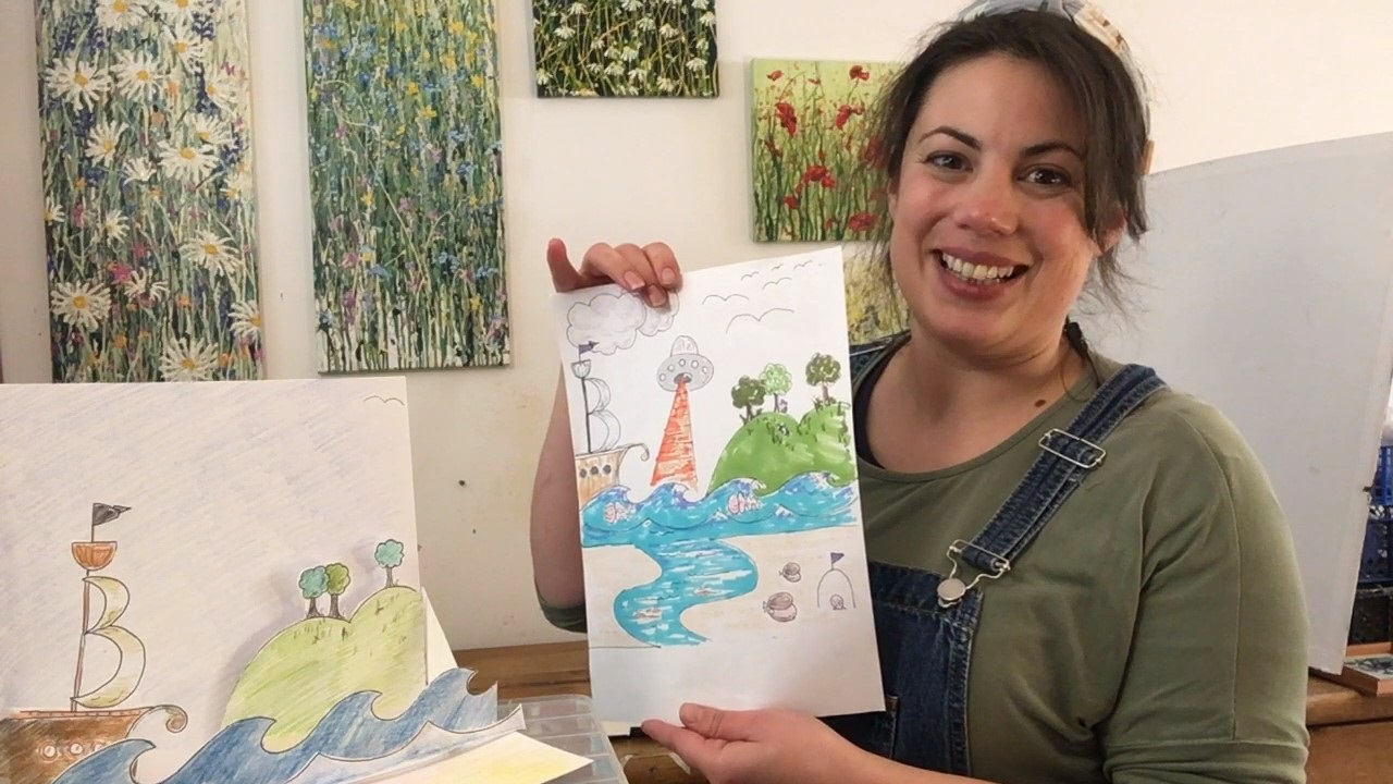 Photo of Artist showing hand drawn picture