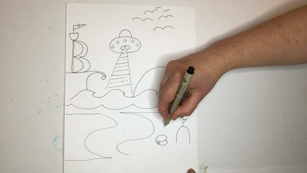 Image of artists hand drawing